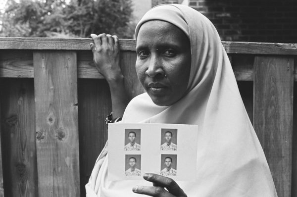 Anna Hill for Settlement Arts, Habibo Waiting For Her Son Hassan Who Lives As A Refugee In Kenya, 2008, Gelatin silver print   16 inch x 20 inch