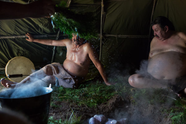Allen Agostino, Garden River Reserve, Ontario, Canada. Members of the Garden River Fire Department relax in between rounds of a Sweat Lodge. The fire department uses the sweat lodge to deal with issues related to PTSD., September 24, 2016
